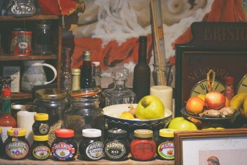 A warm kitchen pantry dressed with red cloth.