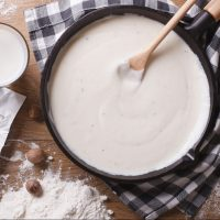 A skillet with homemade Bechamel Sauce.