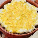 A bowl of Cheddar Mashed Potatoes on top of ground beef