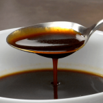 Spooning some delicious Demi Glace Sauce from a bowl