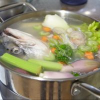 A Fish Fume with vegetables in a pot